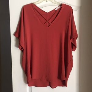 New rust colored cross front blouse